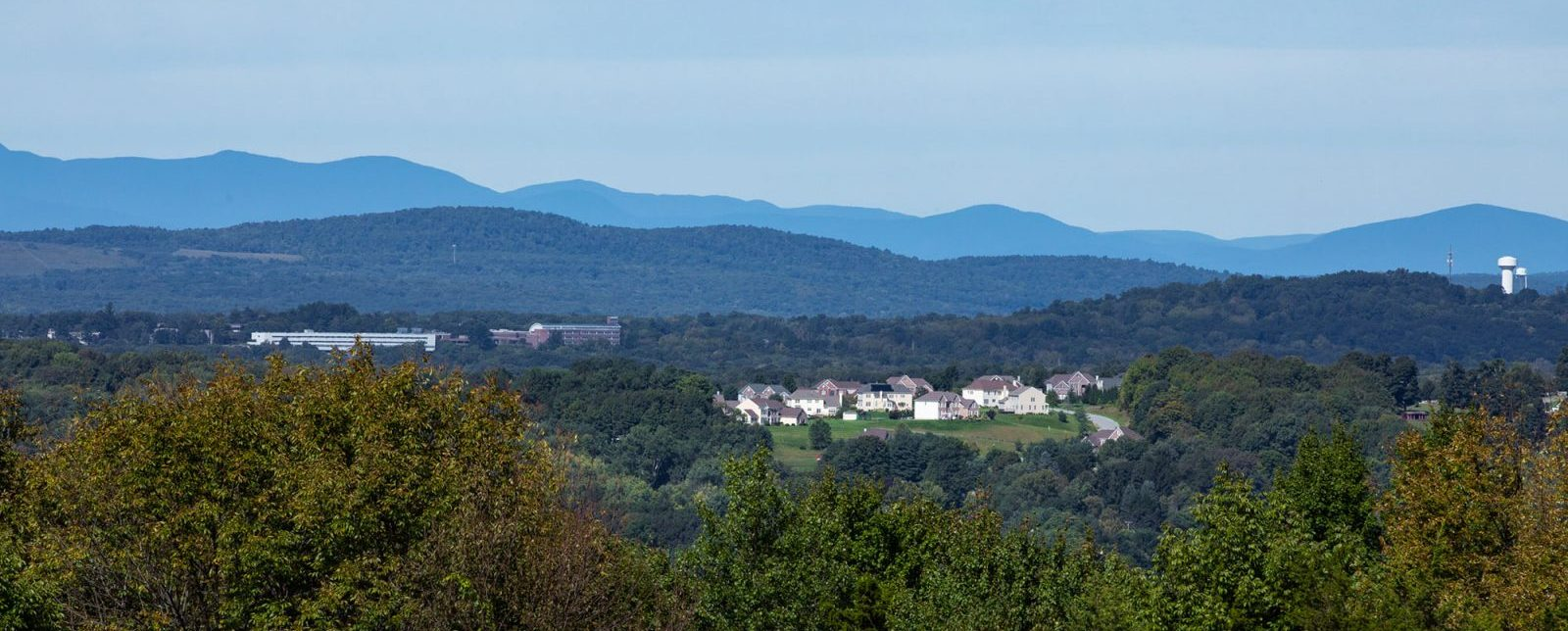 Panoramic view with mountains of Sleight Farm new construction home community in Dutchess County, Hudson Valley, Upstate NY