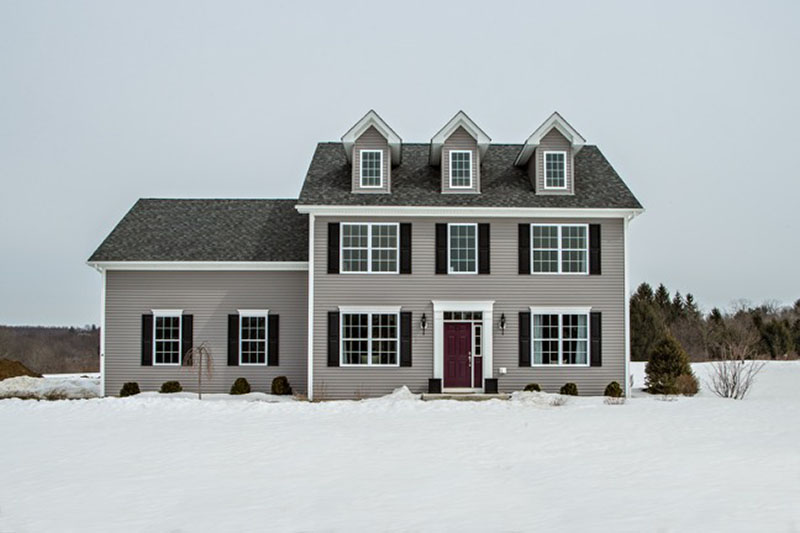 Model new construction home in snow at Sleight Farm in Hudson Valley NY