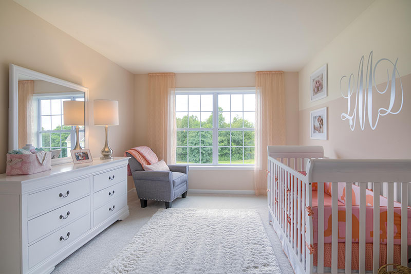 Peach colored nursery in Custom new home from home builder LMD Homes at Sleight Farm in Dutchess County, Hudson Valley, Upstate NY
