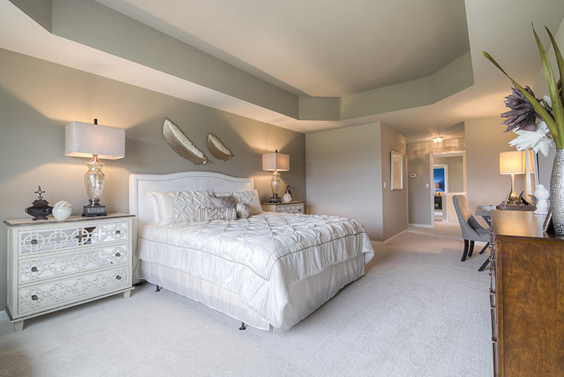 Master bedroom with cantilever ceiling in luxury custom new home at Sleight Farm in Dutchess County NY