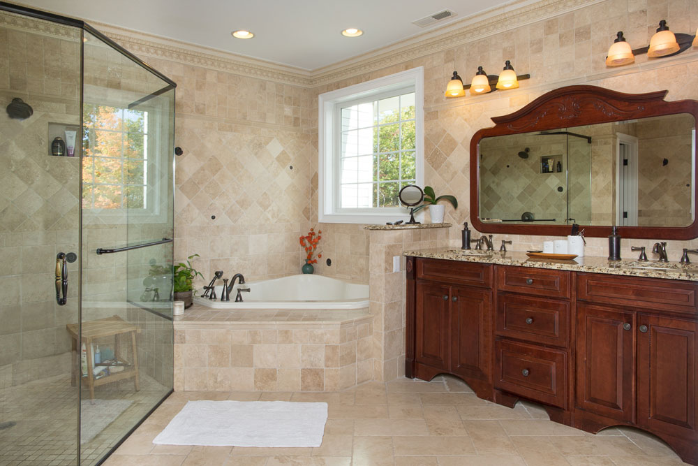 Master Bath with corner tub and glass shower at luxury new home at Sleight Farm in Hudson Valley NY