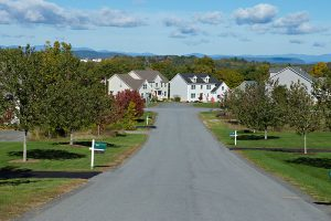 View of a neighborhood street in new construction community Sleight Farm in Hudson Valley NY
