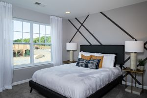 Bedroom in model home at The Glens, part of Sleight Farm's new home community in the Hudson Valley